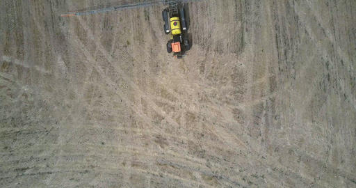upper view trailed sprayer for chemicals turns back on field Live Action