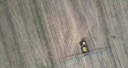 flight over field sprayer for chemicals on harvested field Live Action
