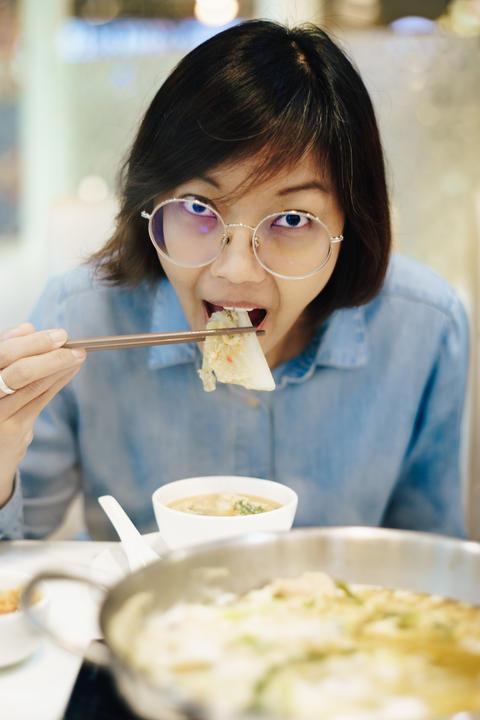 Asian women eating sukiyaki at restuarant Photo