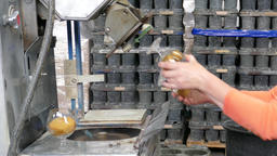 Glassworks. Glassware factory. Employee polishes glass Footage
