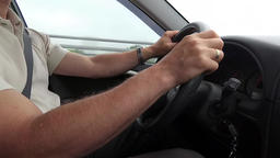 Driving a car - view from inside. Man's hands driving a car. Close up Live Action
