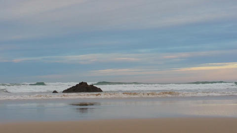 small surf on the sandy beach, in the evening in calm weather Footage