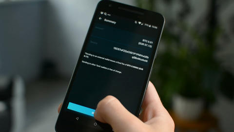 Funds Sent message, sending funds using Bitcoin cryptocurrency with mobile phone Live Action