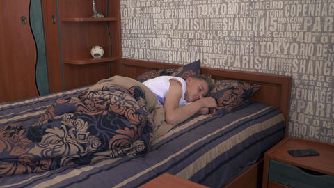 Young man is quietly sleeping in the bed Footage