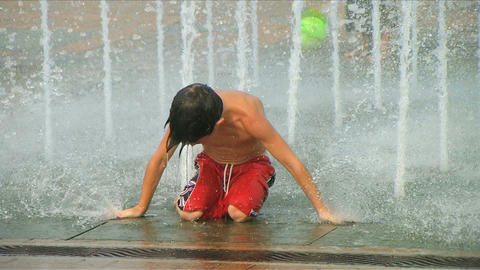 Boy Playing in Fountain Stock Video Footage