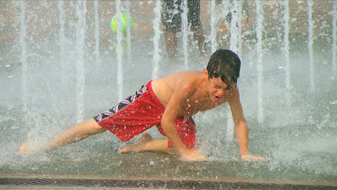 Boy Playing in Fountain Footage