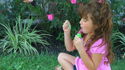 Girl Blowing Bubbles Stock Video Footage