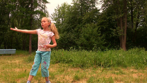Girl dancing on the grass Stock Video Footage