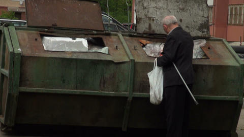 The old man rummaging in the garbage Stock Video Footage