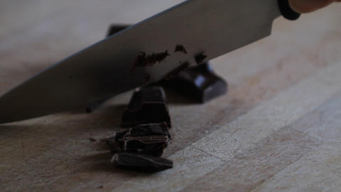 Hand of a woman chopping chocolate Footage