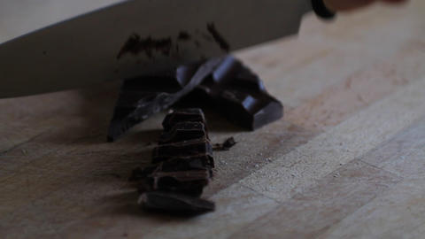 Hand of a woman chopping chocolate Stock Video Footage