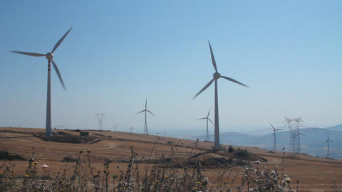 Panoramic of a field of wind turbines Footage