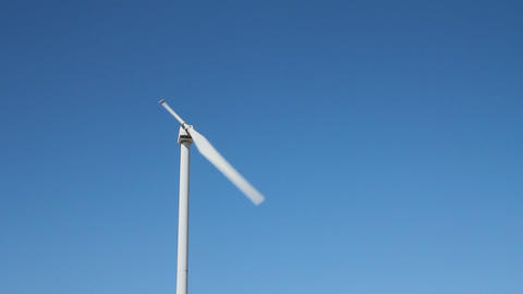 Static shot of a single blade wind turbine Stock Video Footage