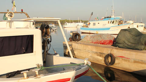 Docked fishing boats with nets drying on the pier Stock Video Footage