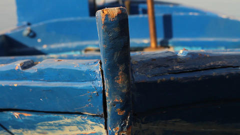 Close up of a docked blue fishing boat Footage