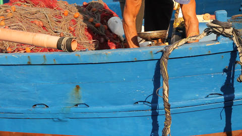 Fishermen working on a boat Stock Video Footage