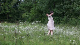 Pregnant woman dancing in the field Stock Video Footage