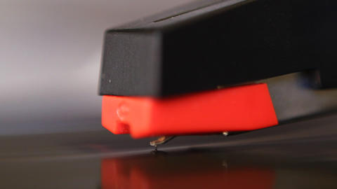 Macro of cartridge and stylus placed on starting r Stock Video Footage