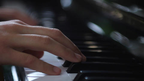 Hands playing piano Stock Video Footage