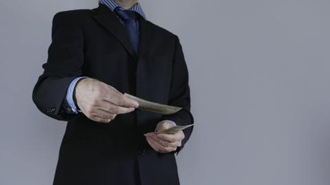 Businessman throws money into camera Footage