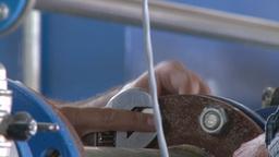 workers tightening steel nut in water pipe, dolly shot Footage