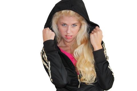 Blonde girl in black jacket, transparent background Photo