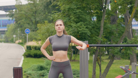 Fitness woman doing warm up exercises on outdoor training Footage