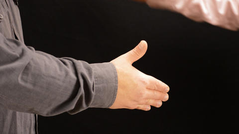 Deal Sealed Handshake Over Black Backdrop Live Action