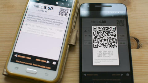 Sending Bitcoin between smartphones by scanning QR code, future of retail Footage
