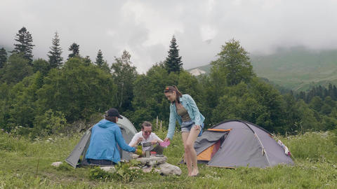 Friends resting in summer camping. People resting near camping tent in forest Footage