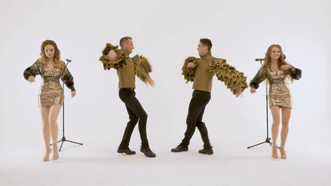Actors of the ballet, two girls two guys dancing in the studio on a white Live Action