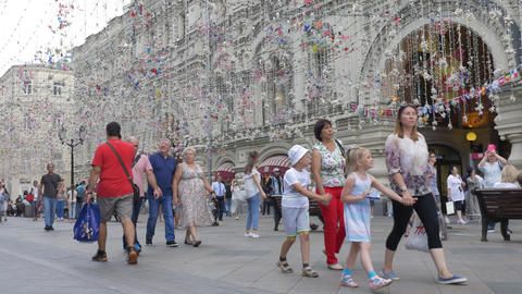 MOSCOW, RUSSIA, JULY 27, 2018. Tourists and guests of the city walk along the Footage