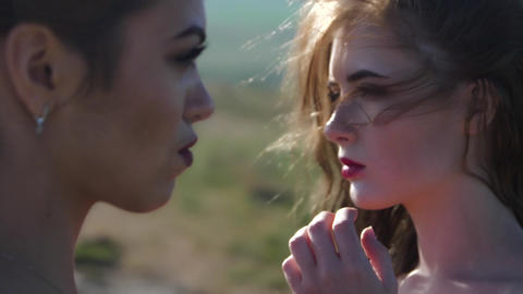 portrait of two women in profile Live Action