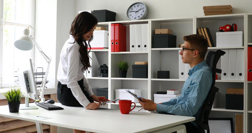 businesswoman sitting at desk and discussing project with manager Footage