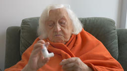 Senior woman inhales medicine for asthma Footage