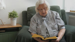 Old woman is reading a book Live Action