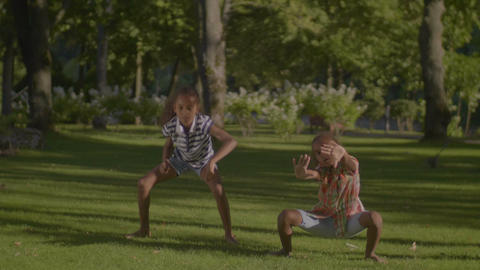 Lovely african american kids dancing hip hop in park GIF