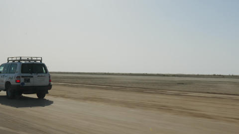 Tunis, Tunisia - 09 June 2018: off road car driving on sandy road while safari Live Action