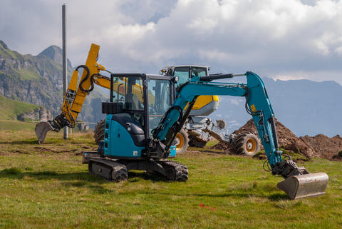 Two excavators on the construction site. Construction of a new cable car on the Fotografía