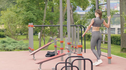 Young woman training on sport ground in summer park. Fitness and sport lifestyle Live Action