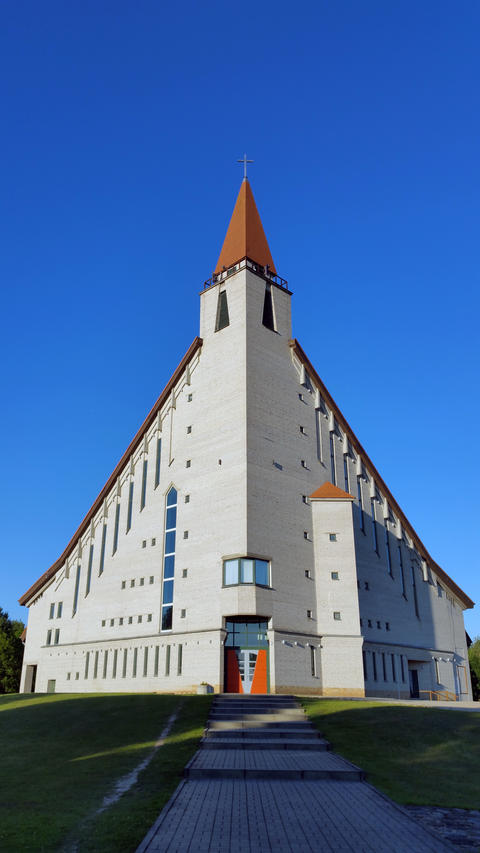 Modern church against blue sky. Bottom view. Naujoji Akmene, Lithuania Photo