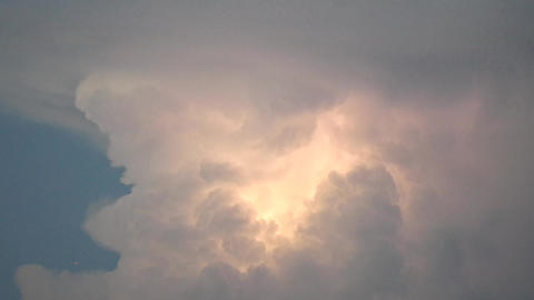 An aircraft passes in front of gigantic cumulonimbus Footage