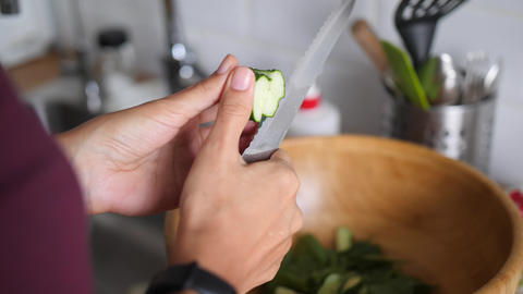 Young Housewife Vegan Girl Cutting Organic Vegetables for Healthy Salad in Live Action