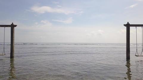 Aerial: Exotic Tropical Paradise Swings in Sea Water. 4K Footage
