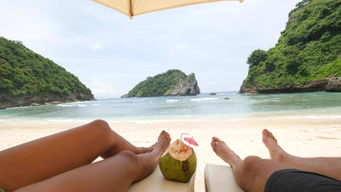 Young Tourist Couple Relaxing on Sandy Beach at Tropical Paradise Island. 4K Footage