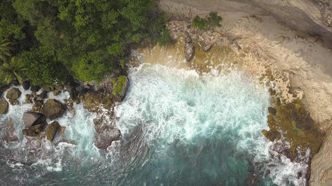 Amazing Cliff Seashore at Paradise Island. Nusa Penida, Indonesia. 4K Aerial Sea Footage