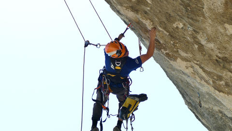 Male Rock Climber Inspection Clifs Live Action