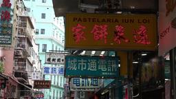 advertising signs shopping street in Macau Footage