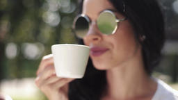 Attractive brunette woman drinking coffee GIF