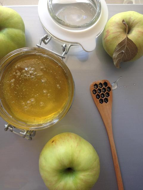 flat lay honey apple and spoon on light background Photo